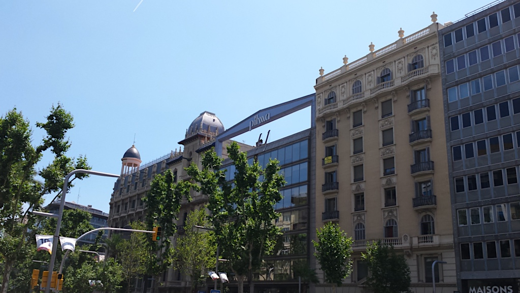 while strolling along the Diagonal, look up and discover the buildings' penthouses